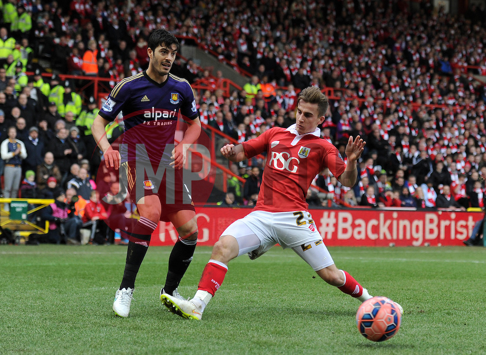 Bristol City's Joe Bryan challenges West Ham's James Tomkins - Photo mandatory by-line: Dougie Allward/JMP - Mobile: 07966 386802 - 25/01/2015 - SPORT - Football - Bristol - Ashton Gate - Bristol City v West Ham United - FA Cup Fourth Round