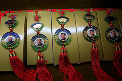 Pictures of Mao Zedong are seen on Chinese knots souvenirs in a souvenir store in Shaoshan, Hunan Province in central China, 28 April 2016. Shaoshan is the hometown of former Communist leader Mao Zedong, popularly known as Chairman Mao. Thousands of visitors descend on this small Chinese town burrowed in the hills of Central China's Hunan province to pay homage to the great helmsman everyday. It is one of the core sites of the 'Red Tourism' industry, where communist party cadres and ordinary Chinese tourists alike seek to relive the experiences and rekindle the spirit of the revolutionaries.