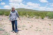 Former Brewster County Judge Val Beard poses for a photo where she and her husband, Tom, found a surveyor trespassing on their ranch near Alpine, Texas on June 17, 2015. (Cooper Neill for The Texas Tribune)