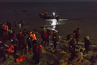 Greece, Chios<br /> <br /> Late at night a refugee boat from Cesme, Turkey arrives near Karfaz at a rocky shore. FEOX Rescue team from Chios (FEOX Nature and Exploration Team) Antonis Vorrias, his brother Michaelis,both age 49, and volunteers from CHIOS EASTERN SHORE RESCUE TEAM helping to bring the refugees, kids, toddlers, women and men safely to the shore and up to the coaststreet near by.<br /> <br /> The refugees are save now. They will get first medical care, dry clothes, tea, water and little food before they get picked up to the registration center in Chios or Vial. <br /> <br /> <br /> keine Veroeffentlichung unter 50 Euro*** Bitte auf moegliche weitere Vermerke achten***Maximale Online-Nutzungsdauer: 12 Monate !!