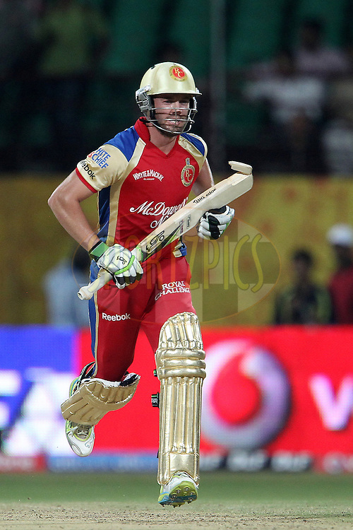 AB de Villiers carries his broken bat to complete the run during the  match 3 of the Indian Premier League ( IPL ) Season 4 between the Kochi Tuskers Kerala and the Royal Challengers Bangalore held at the Jawaharlal International Stadium in Kochi, Kerala, India on the 9th April 2011..Photo by Ron Gaunt/BCCI/SPORTZPICS