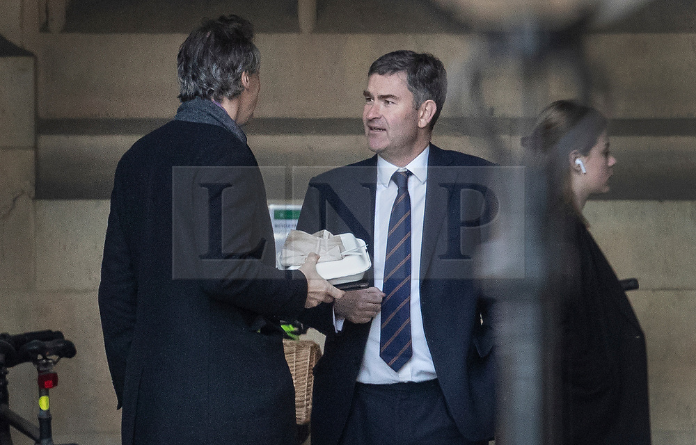 © Licensed to London News Pictures. 12/12/2018. London, UK. Justice Secretary David Gauke (R) talks to Sun political editor Tom Newton Dunn in Parliament. Prime Minister Theresa May will face a vote of confidence later after 48 letters were received to trigger a vote. Photo credit: Peter Macdiarmid/LNP