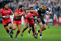 Jonathan Joseph of Bath Rugby takes on the Toulon defence - Mandatory byline: Patrick Khachfe/JMP - 07966 386802 - 23/01/2016 - RUGBY UNION - The Recreation Ground - Bath, England - Bath Rugby v RC Toulon - European Rugby Champions Cup.