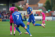 AFC Wimbledon midfielder Mitchell (Mitch) Pinnock (11) celebrating after scoring goal to make it 3-0 during the EFL Sky Bet League 1 match between AFC Wimbledon and Rochdale at the Cherry Red Records Stadium, Kingston, England on 5 October 2019.
