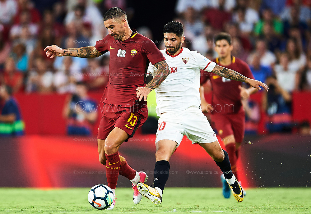 SEVILLE, SPAIN - AUGUST 10:  Aleksandar Kolarov of AS Roma (L) competes for the ball with Ever Banega of Sevilla FC (R) during a Pre Season Friendly match between Sevilla FC and AS Roma at Estadio Ramon Sanchez Pizjuan on August 10, 2017 in Seville, Spain. (Photo by Aitor Alcalde/Getty Images)