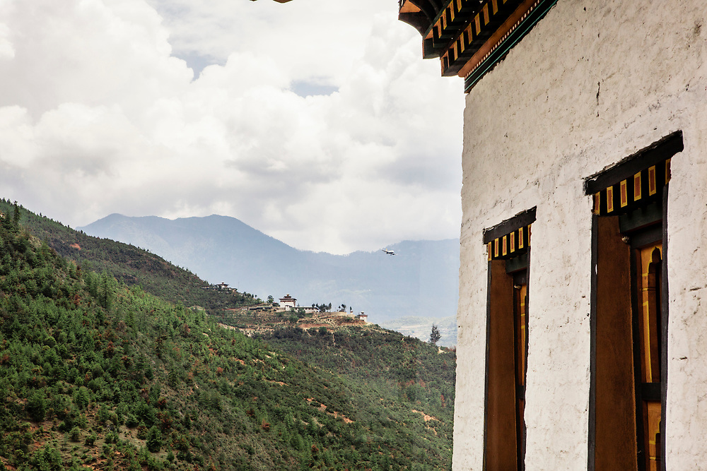 View of Eutok Samdrup Choeling Monastery (and flight coming in for landing) from Bhutan Spirit Sanctuary.