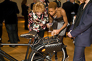 TOLULA ADEYEMI WITH THE PRADA BIKE. The Lighthouse Gala Auction in aid of the Terrence Higgins Trust. Christie's. 23 March 2009.