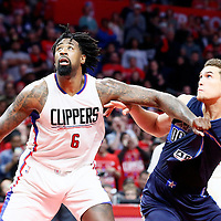 23 December 2016: LA Clippers center DeAndre Jordan (6) vies for the rebound with Dallas Mavericks forward Dwight Powell (7) during the Dallas Mavericks 90-88 victory over the LA Clippers, at the Staples Center, Los Angeles, California, USA.