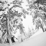 Tyler Hatcher pulls skins for another run in the Cascade backcountry during a winter storm.