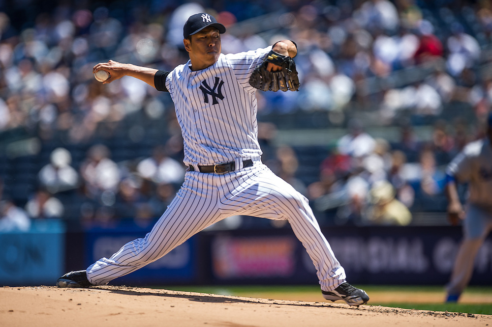 NEW YORK - JUNE 19:  Hiroki Kuroda #18 of the New York Yankees pitches during a game against the Los Angeles Dodgers during the first game of a day-night doubleheader at Yankee Stadium on June 19, 2013 in the Bronx borough of Manhattan. (Photo by Rob Tringali) *** Local Caption *** Hiroki Kuroda
