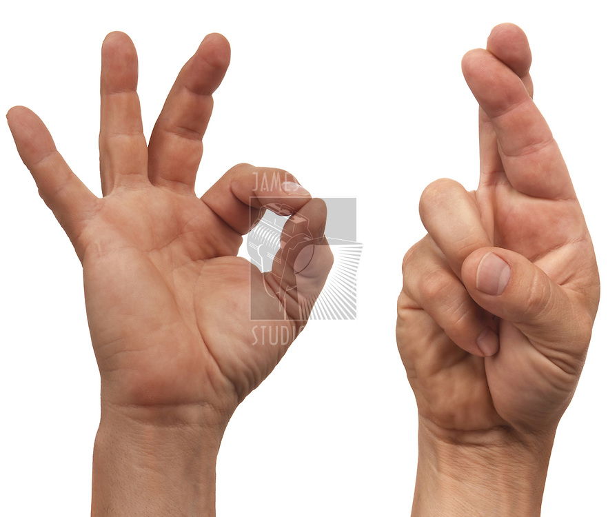 "two male hands making the ""OK"" and fingers crossed sign"
