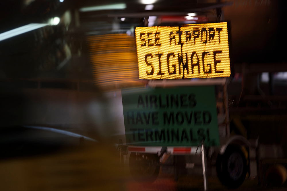 Signage is displayed as traffic drives past advising passengers of airline relocation at Los Angles International Airport (LAX) on Friday, May 12, 2017 in Los Angeles, Calif. Delta Airlines will move from Terminals 5 and 6 to Terminals 2 and 3, forcing 19 other carriers to shift their operations into the facilities vacated by Delta.  © 2017 Patrick T. Fallon