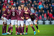 Ryotaro Meshino (#77) of Heart of Midlothian FC is surrounded by team mates after he scores the opening goal during the Ladbrokes Scottish Premiership match between Heart of Midlothian FC and Aberdeen FC at Tynecastle Stadium, Edinburgh, Scotland on 29 December 2019.