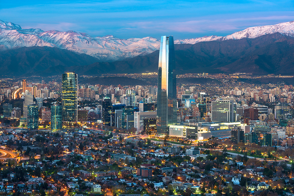 Panoramic view of Providencia and Las Condes districts with Costanera Center skyscraper, Titanium Tower and Los Andes Mountain Range, Santiago de Chile <br />