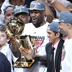Jun 21, 2012; Miami, FL, USA; Miami Heat small forward LeBron James (6) holds up the Larry O'Brien Trophy after winning the 2012 NBA championship at the American Airlines Arena. Miami won 121-106. Mandatory Credit: Derick E. Hingle-USA TODAY SPORTS
