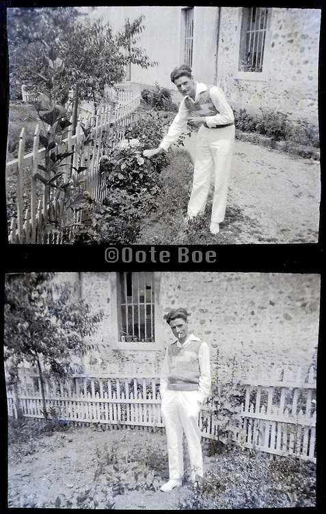 young adult man standing in garden 1900s
