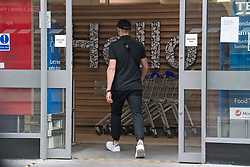 © Licensed to London News Pictures. 24/07/2020. London, UK. A shopper enters Tesco on Goodge Street in central London not wearing a face mask, on the day that the wearing of mask in shops becomes compulsory. The UK Government has published formal guidance on spaces where the wearing of masks will now be mandatory, including in shops, supermarkets and shopping centres. Photo credit: Ben Cawthra/LNP