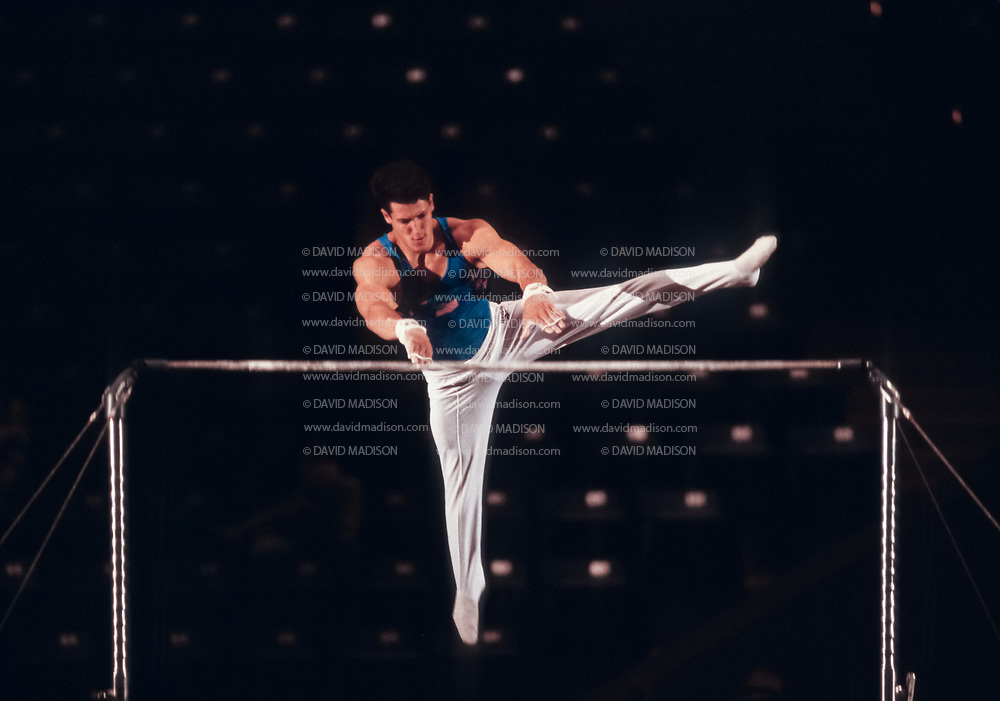 SAN JOSE - JULY 18:  John Roethlisberger of the United States competes on the high bar during the San Jose Gymnastics Spectacular held on July 18, 1993 in the Event Center at San Jose State University in San Jose, California.  (Photo by David Madison/Getty Images)