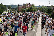 AUGUST 26, 2018  ATHENS, OHIO:<br /> The new freshman class at Ohio University walks up the Richland Avenue to College Green after attending the freshman convocation at the Convocation Center on August 26, 2018 in Athens, Ohio.