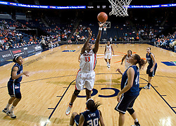 Virginia center Aisha Mohammed (33) shoots over Rhode Island forward Sierra Cooper (30).  The Virginia Cavaliers women's basketball team defeated the Rhode Island Rams 89-53 at the John Paul Jones Arena in Charlottesville, VA on January 9, 2008.
