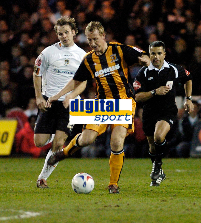 Photo: Leigh Quinnell.<br /> Luton Town v Hull City. Coca Cola Championship. 13/03/2007. Hulls Ray Parlour clears the ball from Lutons Markus Heikkinen.