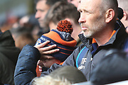 Luton Town fans can't bear to watch as the game slips away during the EFL Sky Bet League 1 match between Burton Albion and Luton Town at the Pirelli Stadium, Burton upon Trent, England on 27 April 2019.