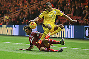 Middlesbrough defender George Friend  fouls Burnley defender Tendayi Darikwa  during the Sky Bet Championship match between Middlesbrough and Burnley at the Riverside Stadium, Middlesbrough, England on 15 December 2015. Photo by Simon Davies.