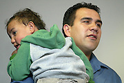 Pero Cameron with son Flynn at a Tall Blacks press conference at the Spencer on Byron Hotel, Takapuna, Auckland, 16 May, 2002. Photo: Chris Skelton/PHOTOSPORT<br />
