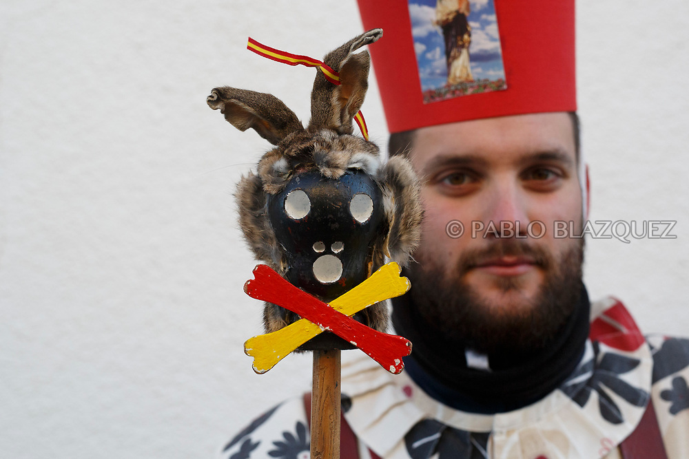 2018/02/02. ALMONACID DEL MARQUESADO, SPAIN - JANUARY 16: Worshipper Cristian Martinez dressed as Diablo 'Devil' poses with his porra 'baton' during the Endiablada 'The Brotherhood of the Devils' festival on February 2, 2018 in Almonacid del Marquesado, Cuenca province, Spain. La Endiablada is a centenary tradition of unknown origins celebrated on Virgen de la Candelaria 'Our Lady of Candelaria' and San Blas 'Saint Blaise' days. The Diablos wear colourful clothes, a hat and carry bells and personalised porras 'batons'. (Photo by Pablo Blazquez Dominguez)