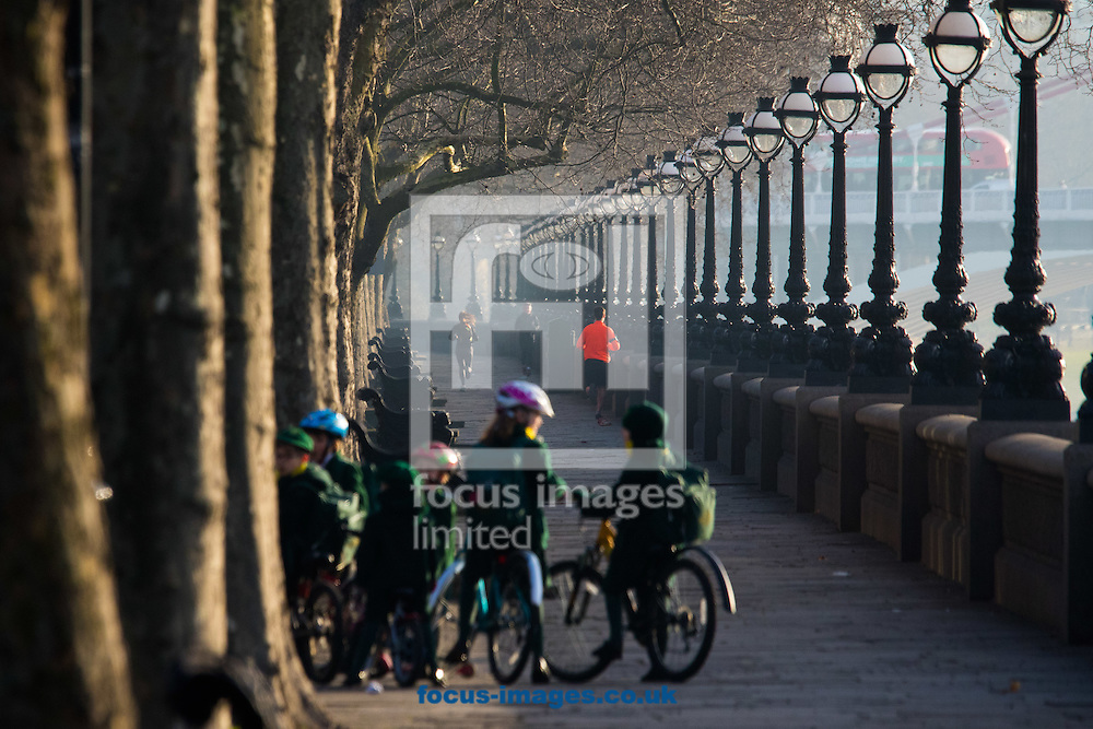 School children and joggers enjoy the morning sunshine at Cheyne Walk, London <br /> Picture by Paul Davey/Focus Images Ltd +447966 016296<br /> 24/02/2016