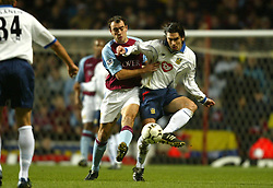 BIRMINGHAM, ENGLAND - Tuesday, January 6, 2004: Aston Villa's Gavin McCann and Portsmouth's Richard Hughes during the Premiership match at Villa Park. (Pic by David Rawcliffe/Propaganda)