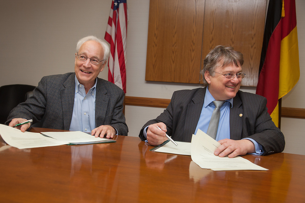 Dr. Hugh Sherman, Dean of OHIO College of Business, left and Professor Herbert Woratschek of University of Bayreuth sign  a Memoradum of Understanding.  Photo by Ohio University / Jonathan Adams