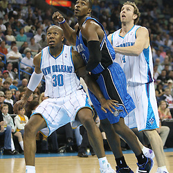 18 February 2009: Orlando Magic center Dwight Howard (12) fights for position between New Orleans Hornets defenders David West (30) and Sean Marks (4) during a NBA basketball game between the Orlando Magic and the New Orleans Hornets at the New Orleans Arena in New Orleans, Louisiana.