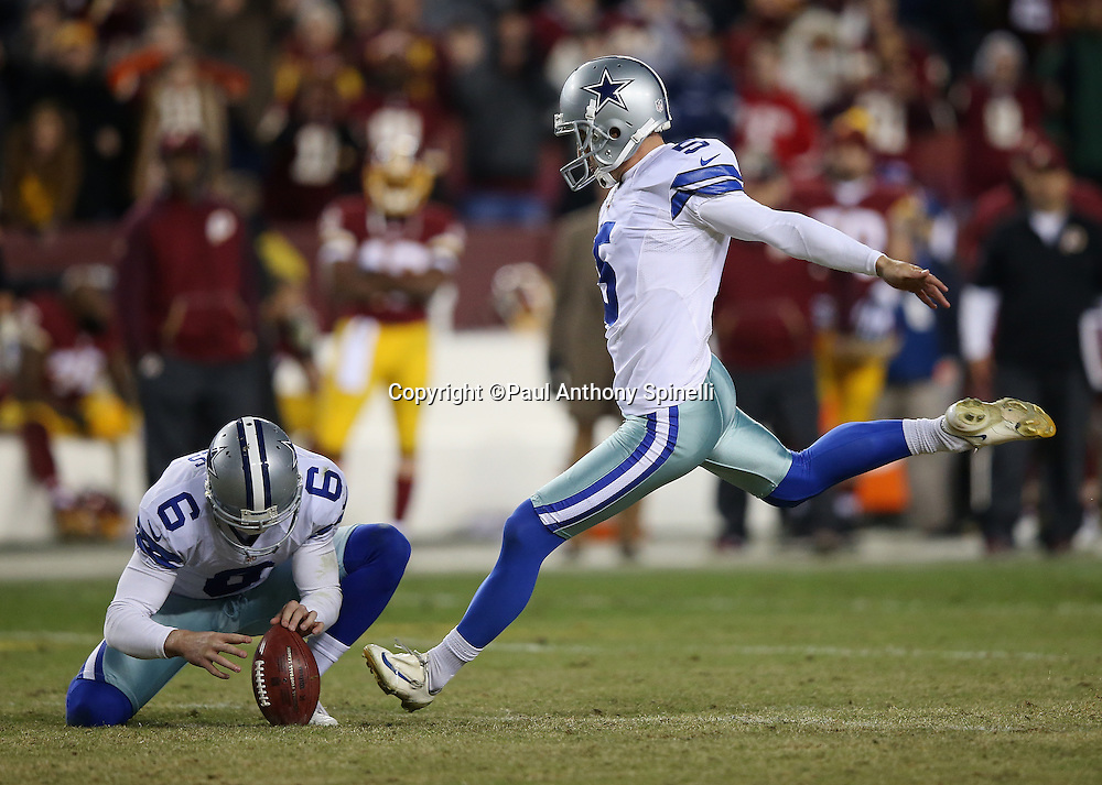 Dallas Cowboys punter Chris Jones (6) holds while Dallas Cowboys kicker Dan Bailey (5) kicks the game winning field goal with 9 seconds left on the game clock during the 2015 week 13 regular season NFL football game against the Washington Redskins on Monday, Dec. 7, 2015 in Landover, Md. The Cowboys won the game 19-16. (©Paul Anthony Spinelli)