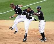 CHICAGO - JULY 09:  Gordon Beckham #15 (L), Alexei Ramirez #10 and Juan Pierre #1 (R) of the Chicago White Sox celebrate after Ramirez drove in the game winning run in the bottom of the ninth inning against the Minnesota Twins on July 9, 2011 at U.S. Cellular Field in Chicago, Illinois.  The White Sox defeated the Twins 4-3.  (Photo by Ron Vesely)  Subject: Gordon Beckham;Juan Pierre;Alexei Ramirez.