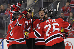 Mar 8; Newark, NJ, USA; The New Jersey Devils celebrate a goal by New Jersey Devils left wing Ilya Kovalchuk (17)  during the second period at the Prudential Center.