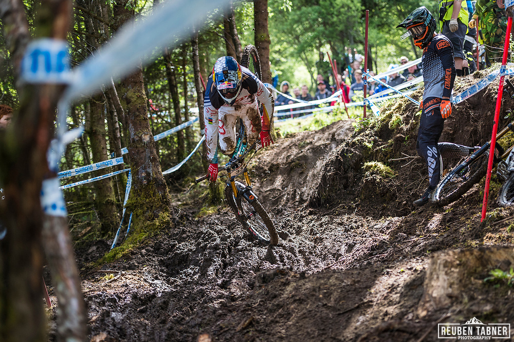 Loic Bruni learns to fly as he attempts to find a way through the mud during Sunday practise at the UCI Mountain Bike World Cup in Fort William.