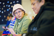 08 DECEMBER 2010 - PHOENIX, AZ: MARIA RUBIO (left) and FELICITAS GILES, both from Phoenix, wait to see doctors at a Mission of Mercy mobile clinic in Phoenix, AZ, Wednesday, Dec. 8. Mission of Mercy has been providing free medical help for people in the Phoenix area since 1997. In the last two years, as the Arizona economy continued its recessionary slide, patient load at the clinics has more than doubled. Mission of Mercy, which relies on voluntary medical help and financial donations, recently acquired another mobile clinic so they could expand their reach into suburban areas they previously had not served. Mission of Mercy has provided free medical help to more than 43,000 patients in the Phoenix area since 1997.    PHOTO BY JACK KURTZ