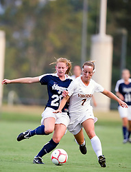Georgetown Hoyas defender Norah Swanson (20) and Virginia Cavaliers midfielder/forward Caitlin Miskel (7) battle for possession.  The #6 Virginia Cavaliers played the Georgetown Hoyas to a 2-2 draw in a NCAA Women's Soccer pre-season exhibition game held at Klockner Stadium on the Grounds of the University of Virginia in Charlottesville, VA on August 18, 2008.