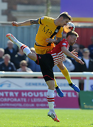 Southend United's Jake Cassidy challenges for the high ball with Exeter City's Scott Bennett - Photo mandatory by-line: Harry Trump/JMP - Mobile: 07966 386802 - 18/04/15 - SPORT - FOOTBALL - Sky Bet League Two - Exeter City v Southend United - St James Park, Exeter, England.