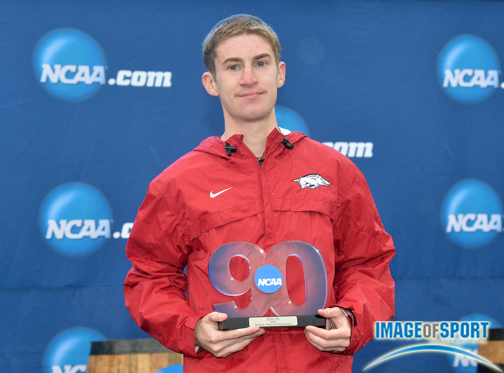 Nov 21, 2015; Louisville, KY, USA; Christian Heymsfield of Arkansas poses with the NCAA Elite 90 trophy for highest grade point average among participants during the 2015 NCAA cross country championships at Tom Sawyer Park.