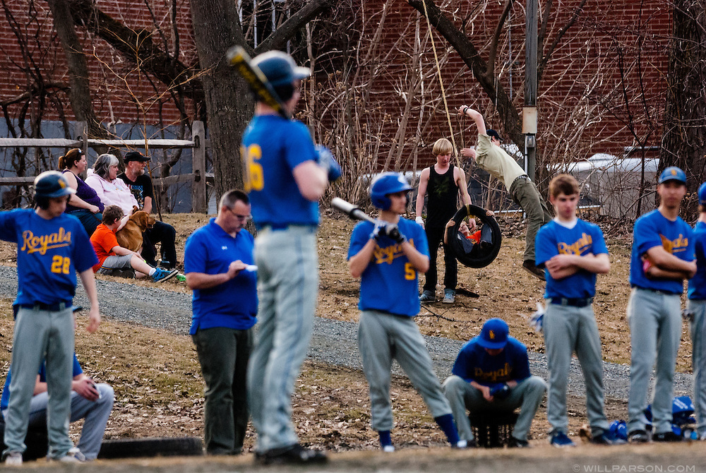 Fans find distration with a tire swing during South Royalton's baseball season opener against Montpelier in South Royalton, Vt., on April 14, 2014. South Royalton won, 10-8. (Valley News - Will Parson)