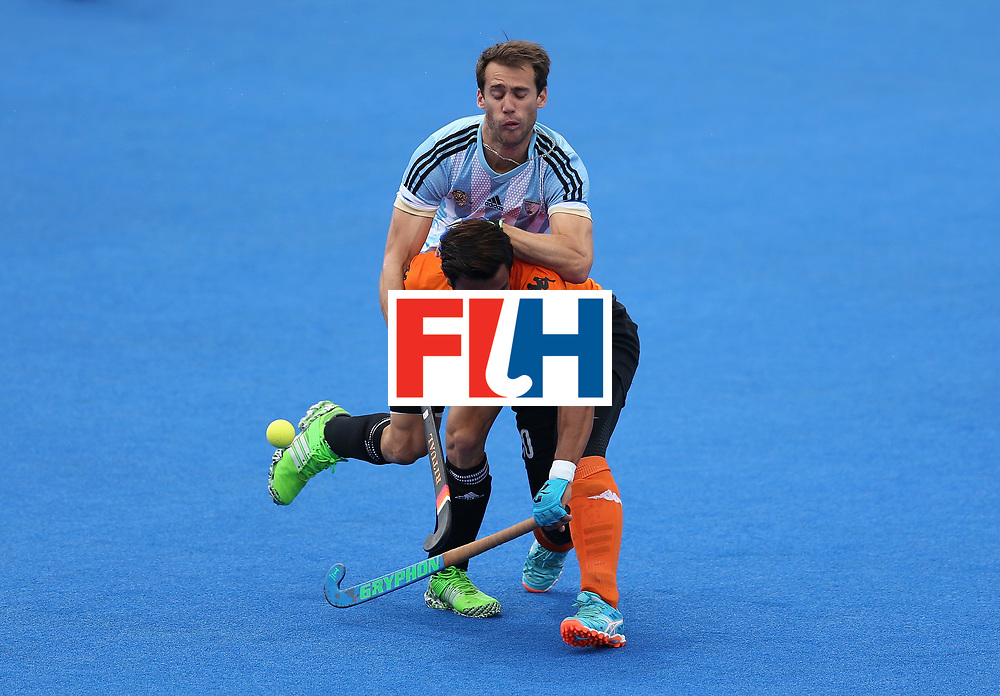 LONDON, ENGLAND - JUNE 24:  Juan Lopez of Argentina and Izad Jamaluddin of Malaysia battle for possession during the semi-final match between Argentina and Malaysia on day eight of the Hero Hockey World League Semi-Final at Lee Valley Hockey and Tennis Centre on June 24, 2017 in London, England.  (Photo by Steve Bardens/Getty Images)