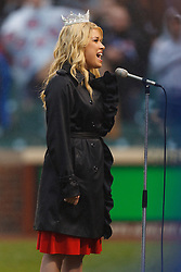 May 14, 2011; Chicago, IL, USA;  Miss America Teresa Scanlan sings the national anthem before the game between the Chicago Cubs and the San Francisco Giants at Wrigley Field.
