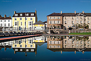 Beaumaris reflected in the paddling pool on the seafront on a crystal clear day. <br /> <br /> This print is only available in the unlimited A3 & A4 sizes