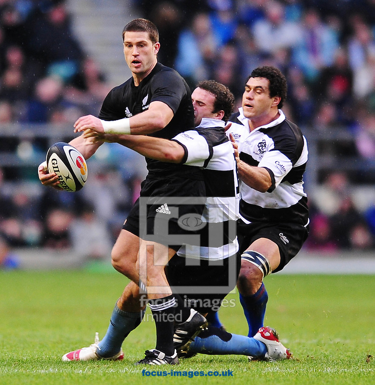 London - Saturday, December 5th 2009: Cory Jane of New Zealand is tackled by Jamie Roberts of Barbarians  during the game at Twickenham, London. ..(Pic by Alex Broadway/Focus Images)