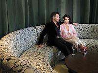 Couple having wine in hotel lobby