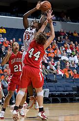 Virginia center Aisha Mohammed (33) shoots over Davidson guard-forward Danielle Hemerka (44).  The Virginia Cavaliers women's basketball team defeated the Davidson Wildcats 83-68 at the John Paul Jones Arena in Charlottesville, VA on December 20, 2007.
