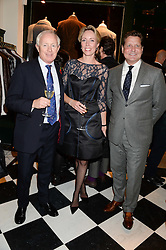 Left to right, SIMON BREWER, REBECCA BREWER and CRAIG REYNOLDS CEO of Kent & Curwen at the Kent and Curwen London Flagship Launch, Saville Row, London on 6th November 2013.