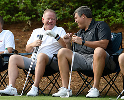 Notre Dame head football coach Brian Kelly and Ole Miss head football coach Matt Luke during the Chick-fil-A Peach Bowl Challenge Closest to the Pin Skills Competition at the Ritz Carlton Reynolds, Lake Oconee, on Monday, April 29, 2019, in Greensboro, GA. (Dale Zanine via Abell Images for Chick-fil-A Peach Bowl Challenge)